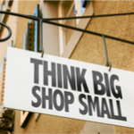 thinking big shop small sign